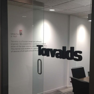 Gamma installed dimensional letters and cut letter vinyl at Vail Systems.